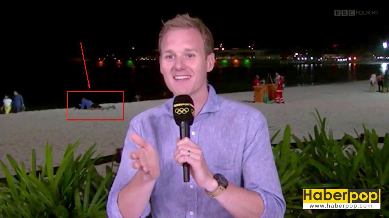 BBC-muhabiri-canlı-yayındayken-arkasındaki-çiftler-sevişti-video-izle