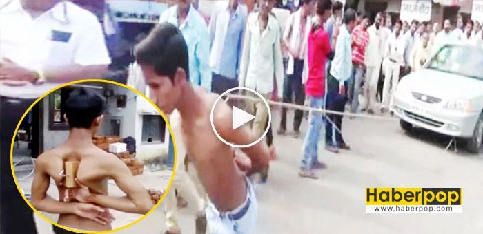 Hintli-genç-1-tonluk-arabayı-köprücük-kemikleriyle-çekti-videosu-izle-ilginç