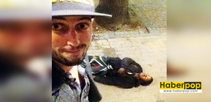 hırsızı-dövüp-başında-selfie-çekti-haberpop-oku